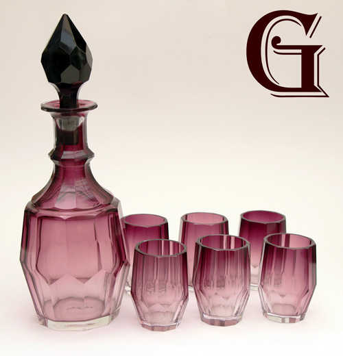 An amethyst shaded liqueur decanter and six tots Moser