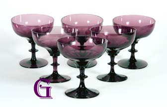 A set of six all amethyst champagne glasses with cut facet bowls