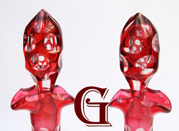 pair of cranberry hock decanters optic cut