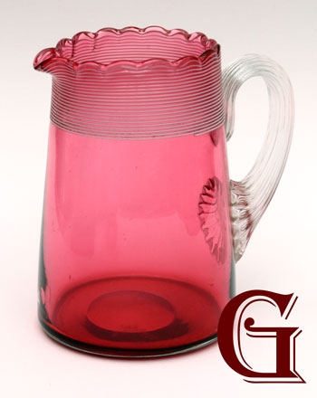 cranberry glass jug with white machine threading and reeded handle