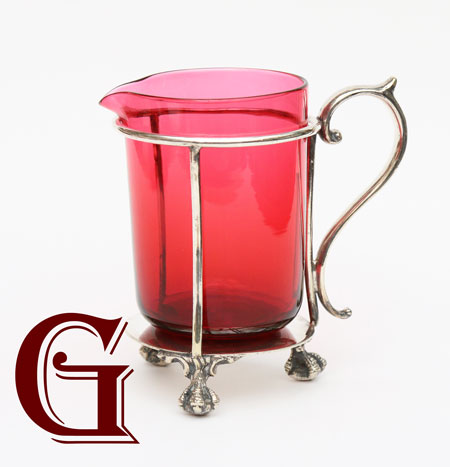 Cranberry glass milk  jug  EPNS stand