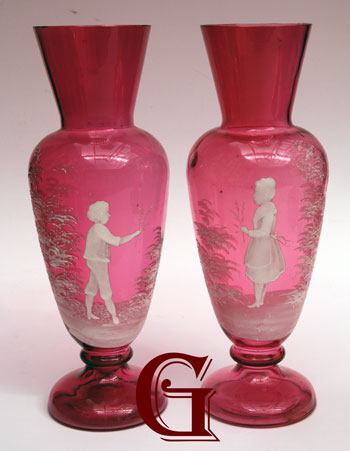 pair of cranberry glass Mary Gregory vases