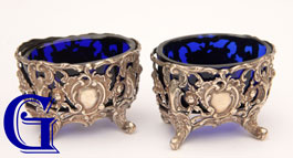 A PAIR OF COBALT BLUE SALTS IN SIVER PLATED ROCOCO STANDS