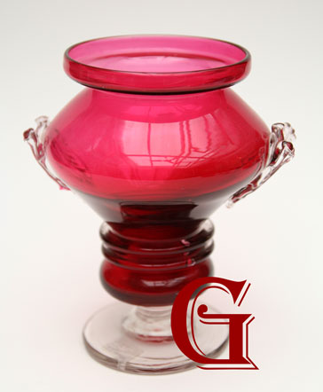 A cranberry glass vase